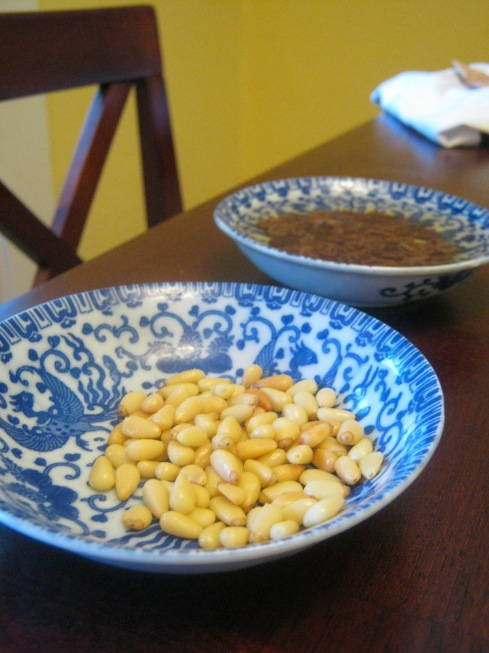 toasted pine nuts and plumped raisins